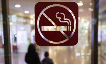 Shanghai stubs out smoking indoors, driving push for national ban