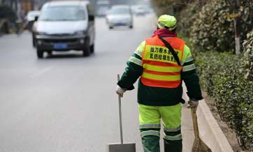 Cleaners' special waistcoat calls for less litter