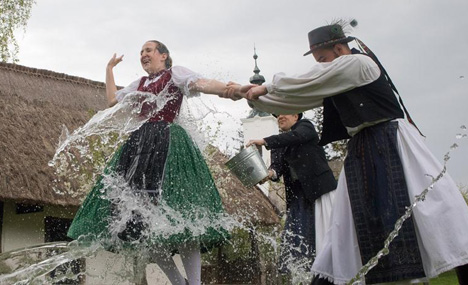 People participate in Watering of girls to celebrate Easter