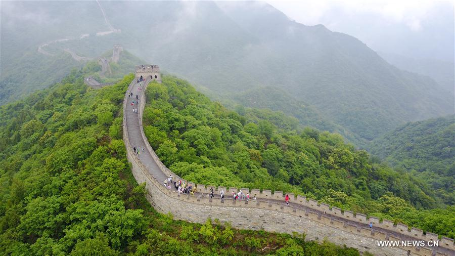 People visit Mutianyu section of Great Wall in mist and rain in Beijing
