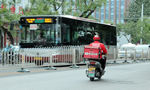 Pressure to arrive on time leads food deliverymen to break traffic laws