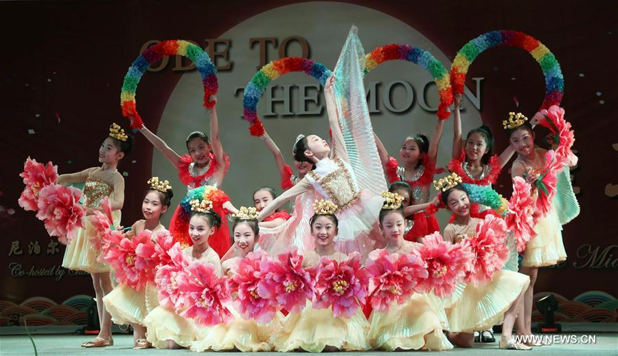 Children dance to celebrate Chinese Mid-Autumn Festival in Nepal