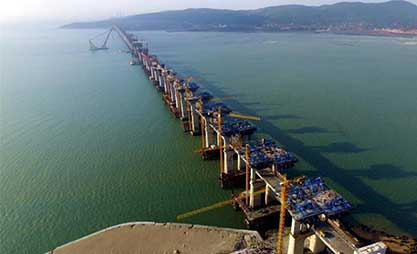 China's first cross-sea rail-road bridge takes shape