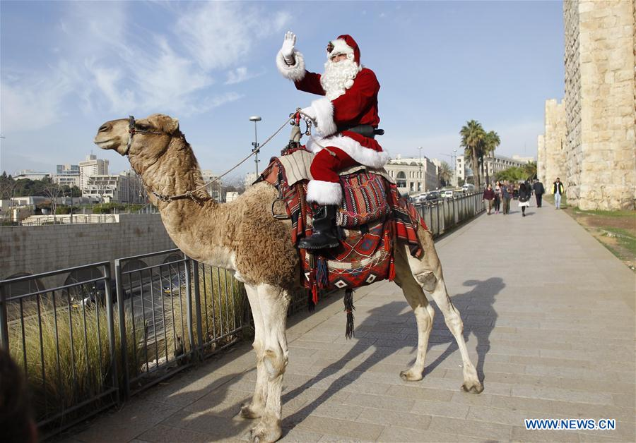 Man dressed as Santa Claus rides camel in Jerusalem's Old City