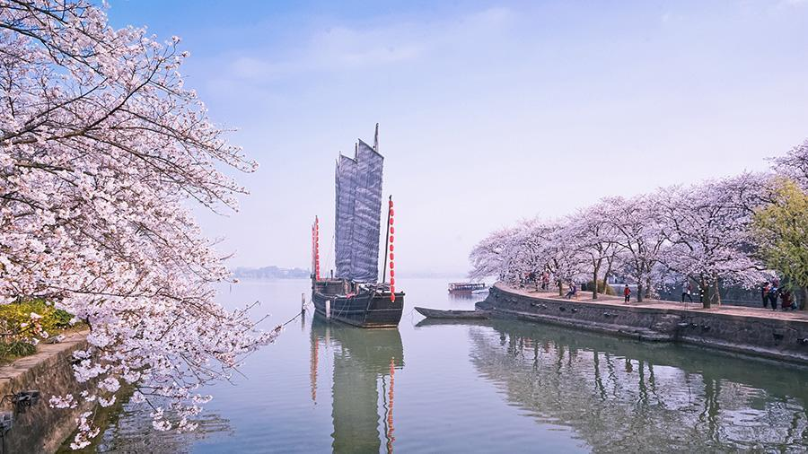 Top 10 easiest chinese cities to do business 7 peoples daily online a view of cherry blossoms at the yuantouzhu turtle head isle scenic spot in wuxi east chinas jiangsu province on march 25 wuxi a city characterized publicscrutiny