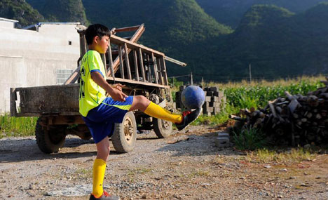 Poor mountain children kick out a new life with football