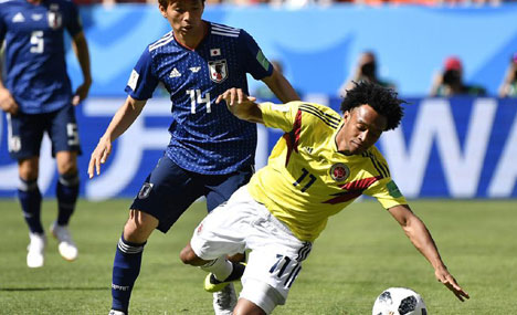 World Cup: Japan defeats Colombia 2-1