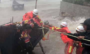 580,000 evacuated, as typhoon hits land