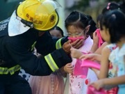 Children participate in drill of fire emergency