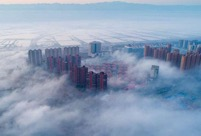 Aerial photos show fog floating above Yuncheng City in north China