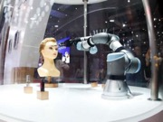 AI robot that can do makeup exhibited at CIIE