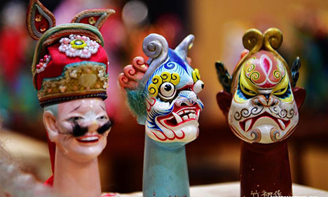 Chinese craftsmen devoted to Zhangzhou wood puppet head carving