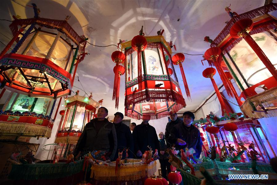 People make horse race lamps to celebrate Chinese Lunar New Year in Shandong