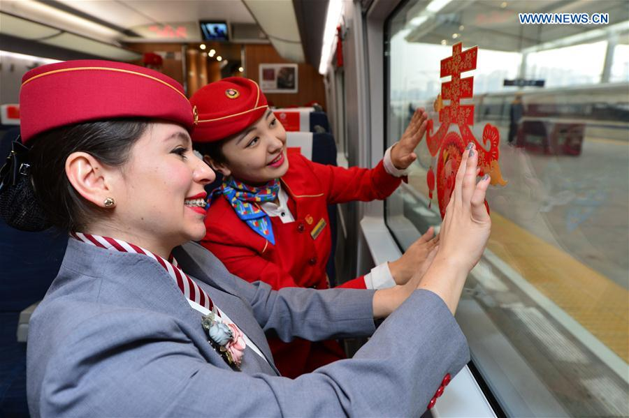 Foreign volunteers serve passengers during Spring Festival travel rush in China's Xi'an