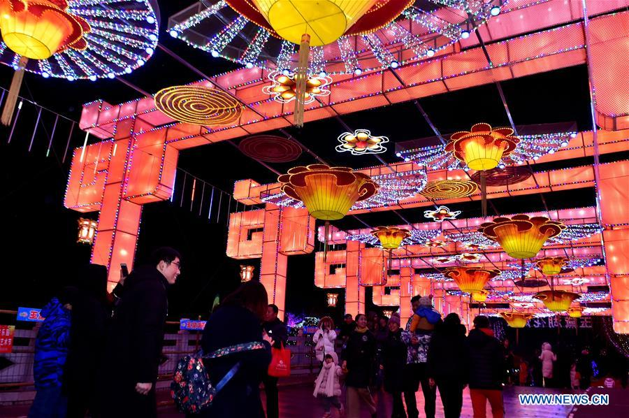 Visitors view lanterns at a lantern show in Zibo, east China's Shandong Province, Feb. 18, 2019. Many places across the country are decorated with lanterns to celebrate the upcoming Lantern Festival, which falls on Feb. 19 this year. (Xinhua/Yuan Deliang)