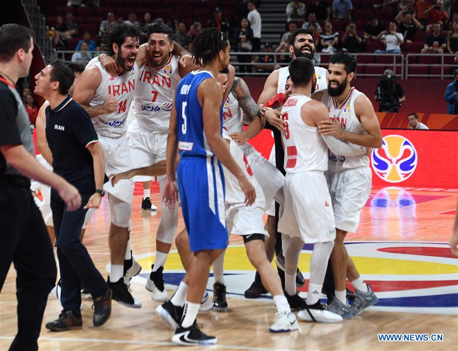Players of Iran celebrate after the group N match between Iran and the Philippines at the 2019 FIBA World Cup in Beijing, capital of China, Sept. 8, 2019. (Xinhua/Zhang Chenlin)