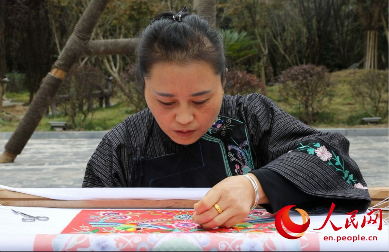 Miao villagers embroider their way to wealth