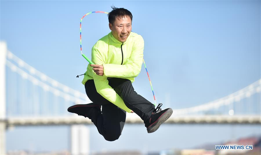 Pic story of rope jumping coach in Jilin, NE China's Jilin