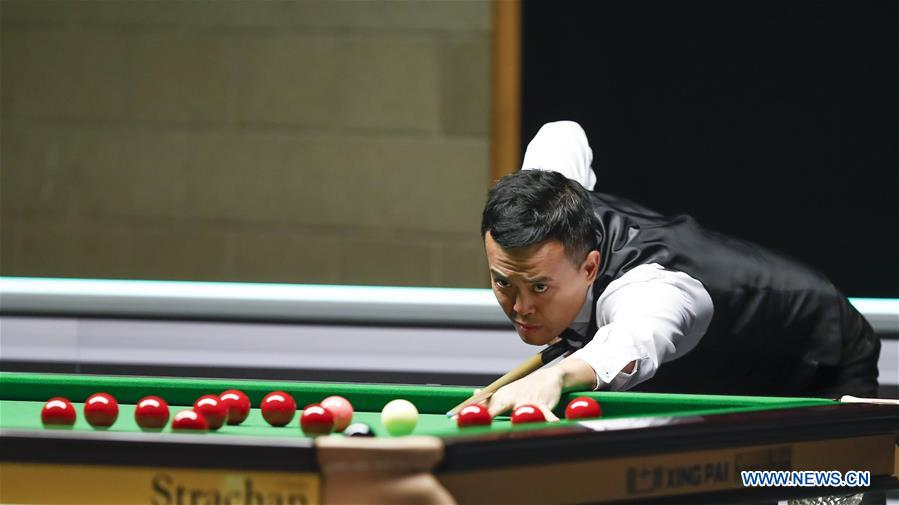 Marco Fu of Hong Kong of China competes during the Snooker UK Championship 2019 first round match with Craig Steadman of England in York, Britain on Nov. 27, 2019. (Xinhua/Han Yan)