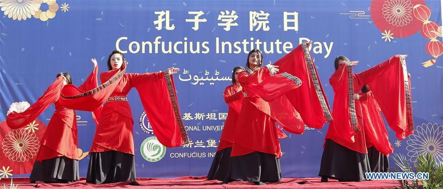Pakistani students perform during Confucius Institute Day event at the National University of Modern Languages in Islamabad, capital of Pakistan on Dec. 17, 2019. The Confucius Institute at the National University of Modern Languages in Islamabad celebrated the Confucius Institute Day on Tuesday. During the celebration, visitors enjoyed Chinese culture including traditional clothing, Chinese tea, martial arts and paper-cutting. (Xinhua/Ahmad Kamal)