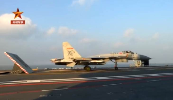 China's Shandong Aircraft Carrier with J-15 Fighter training aboard