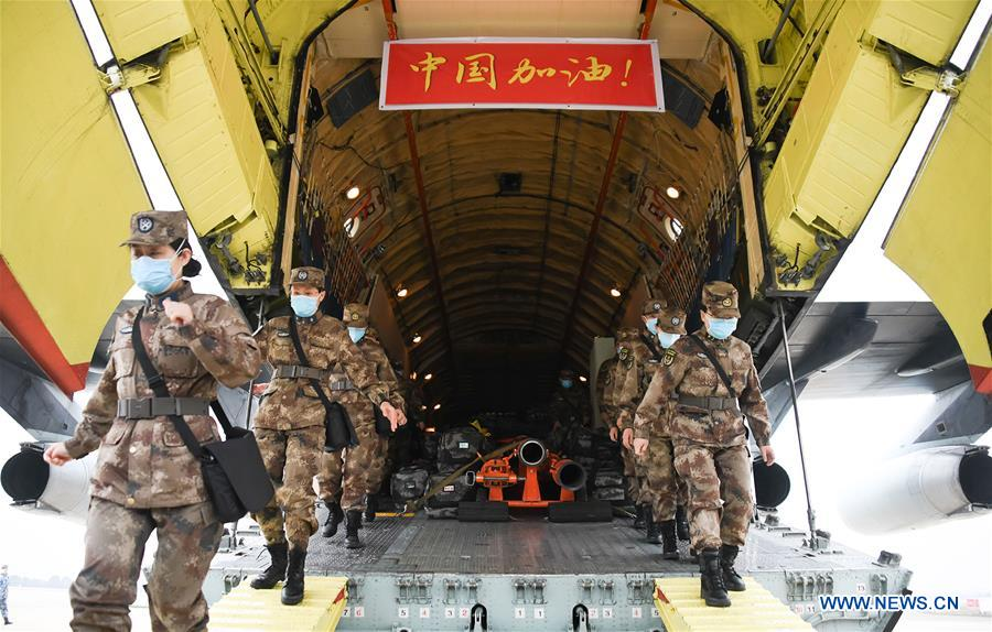 <em>Military medical staff airlifted by eight large transport planes of the air force of the People's Liberation Army (PLA) arrive at Tianhe International Airport in Wuhan, central China's Hubei Province, Feb. 2, 2020. (Xinhua/Cheng Min)</em>