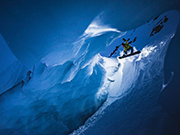 Daredevil snowboards in narrow ice cave