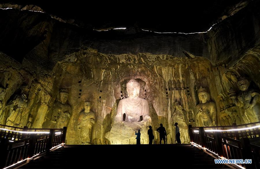 Tourists take part in night tour at Longmen Grottoes scenic area