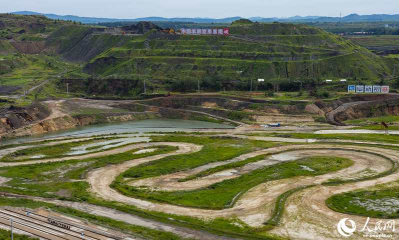 From dust to gold: NE Chinese coal city converts abandoned mine pit into racetrack