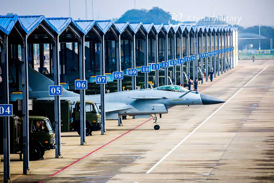 Fighter jets head for take-off on taxiway before flight