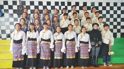 A group photo of Padma Qogco (second from right) and students in the school choir of Yanjing Middle School. (File photo)