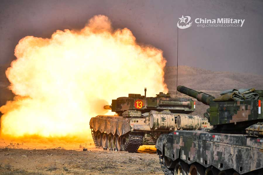 Tanks fire towards simulated enemies