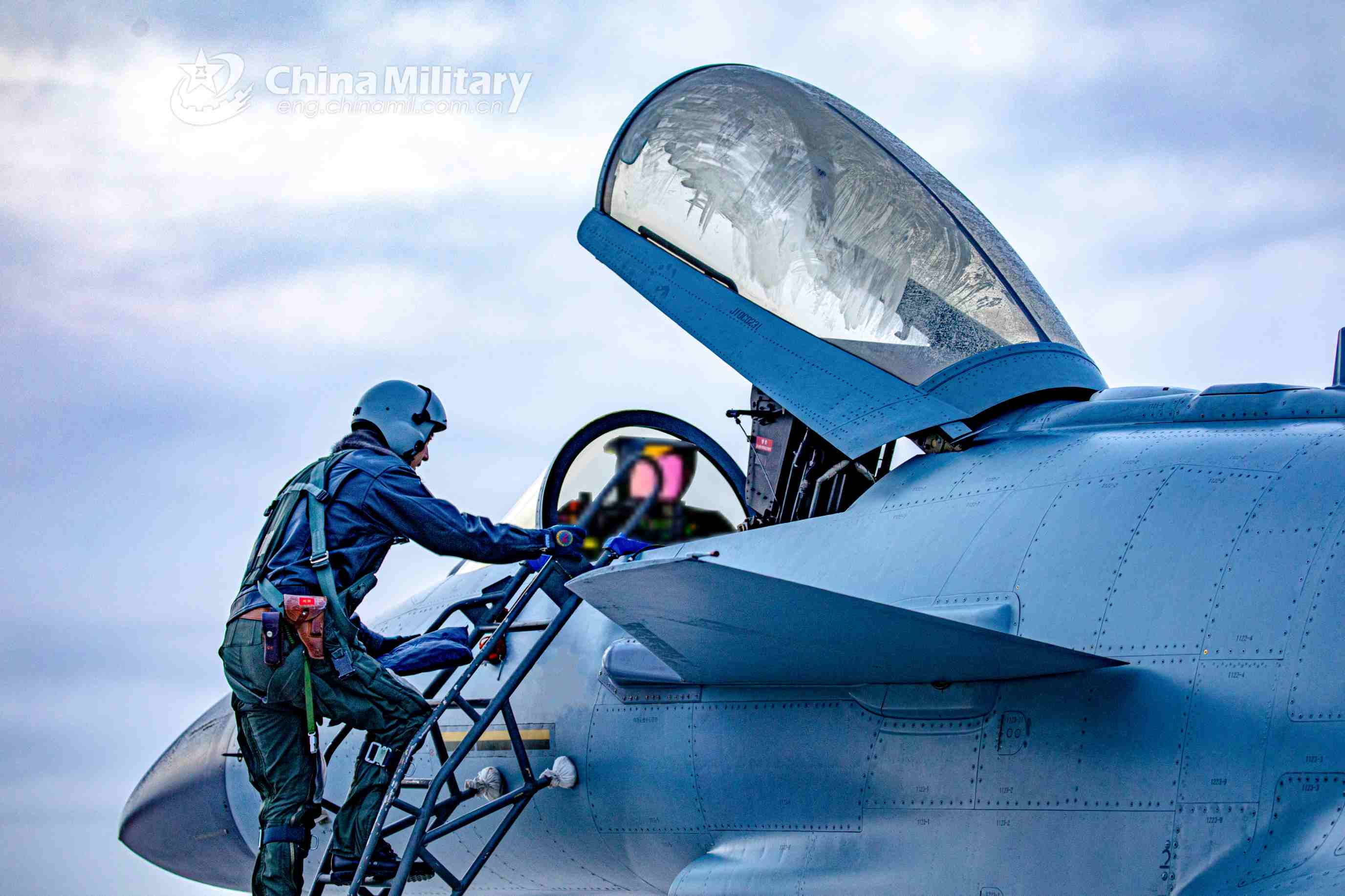 A pilot assigned to an aviation brigade of the air force under the PLA Southern Theater Command climbs into the cockpit of his J-10 fighter jet prior to an aerial combat training exercise in late November, 2020. (eng.chinamil.com.cn/Wang Guoyun)