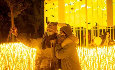 People greet New Year at Happy Valley in Wuhan