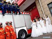 Fire brigade in Shanghai holds group wedding