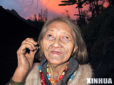 Lapei Nani of the Derung ethnic group shows her tattooed face in Drung-Nu