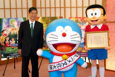 Japans Cartoon Character Doraemon C Who Has Been Appointed As The Nations First Anime Ambassador Poses With Foreign Minister Masahiko Komura L And