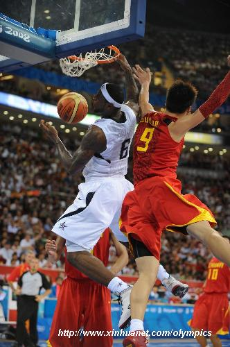 lebron james dunk. Lebron James (L) of USA dunks