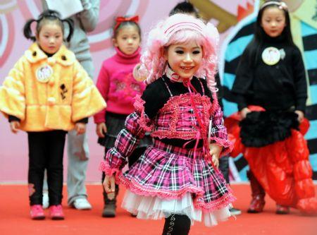 girls fashion show A little girl shows her dress