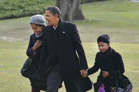 U.S. President Obama returns from vacation