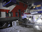 Runaway train carriage removed from hotel building in Helsinki