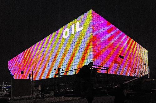 Oil Pavilion of World Expo illuminated in test run