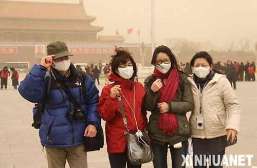 Sandstorm covers Beijing with orange dust