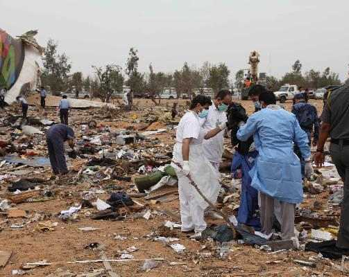 Rescue workers examine debris at Tripoli airport