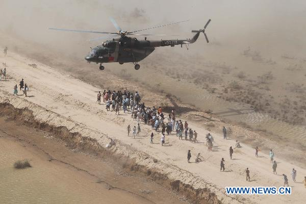 Chinese helicopter rescue team release relief materials to Pakistani flood victims