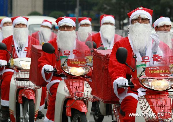 Postmen wear Santa Claus costumes in S Korea