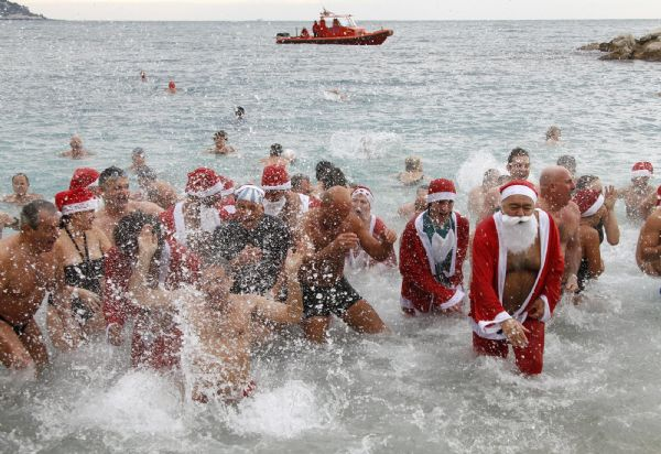 Santa Clauses are swimming!