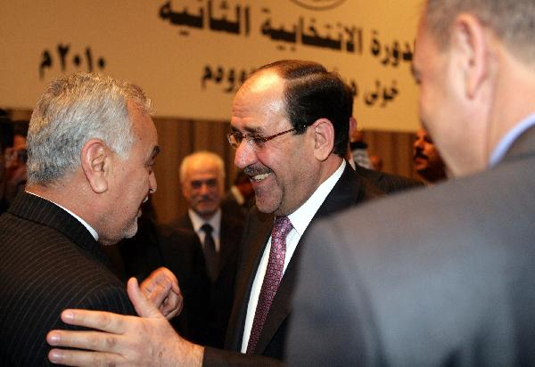 Iraq approves new government with Maliki as PM
