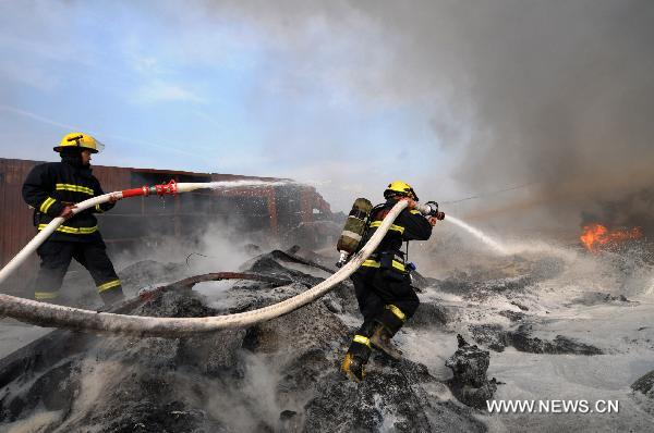 Fire put out in plastic plant in E China