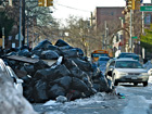 Heavy snow hits New York, streets pile with garbage